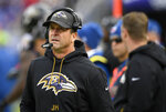 FILE - In this  Sunday, Nov. 18, 2018 file photo, Baltimore Ravens head coach John Harbaugh walks on the sideline in the first half of an NFL football game against the Cincinnati Bengals in Baltimore. Ravens coach John Harbaugh has received a new four-year contract following a season in which he guided Baltimore to the AFC North title. The new deal is designed to keep the winningest coach in Ravens history under contract through the 2022 season. It replaces a pact that was slated to end after next year. (AP Photo/Nick Wass, File)
