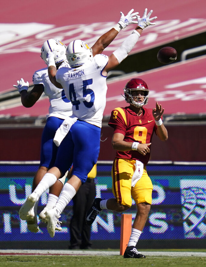 Southern California quarterback Kedon Slovis (9) throws a pass while defended by San Jose State linebacker Alii Matau, left, and linebacker Kyle Harmon (45) of an NCAA college football game during the first half Saturday, Sept. 4, 2021, in Los Angeles. (AP Photo/Ashley Landis)
