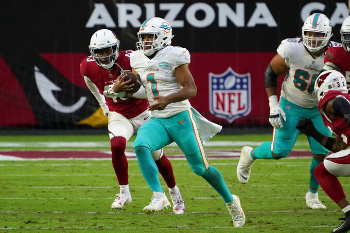 Miami Dolphins quarterback Tua Tagovailoa (1) runs as Arizona Cardinals outside linebacker Haason Reddick (43) pursues during the second half of an NFL football game, Sunday, Nov. 8, 2020, in Glendale, Ariz. (AP Photo/Rick Scuteri)