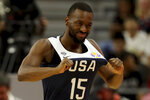United States' Kemba Walker pulls on his jersey during a consolation playoff game against Serbia for the FIBA Basketball World Cup in Dongguan in southern China's Guangdong province on Thursday, Sept. 12, 2019. The U.S. will leave the World Cup with its worst finish ever in a major international tournament, assured of finishing no better than seventh after falling to Serbia 94-89 in a consolation playoff game on Thursday night. (AP Photo/Ng Han Guan)