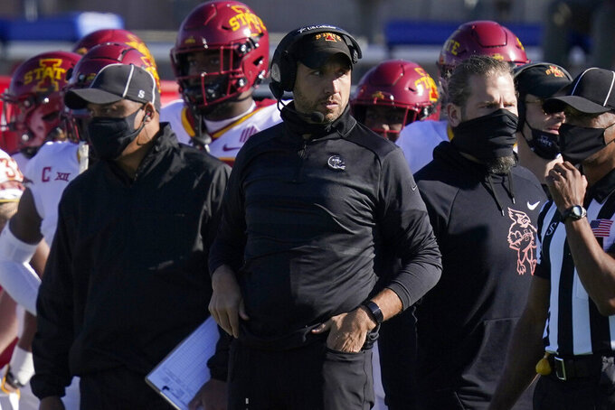 Iowa State head coach Matt Campbell watches from the sidelines during the first half of an NCAA college football game against Kansas in Lawrence, Kan., Saturday, Oct. 31, 2020. (AP Photo/Orlin Wagner)
