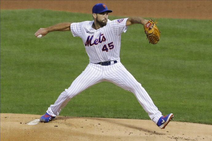New York Mets' Michael Wacha (45) delivers a pitch during the first inning of a baseball game against the Miami Marlins Friday, Aug. 7, 2020, in New York. (AP Photo/Frank Franklin II)