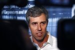 Former Texas congressman and Democratic presidential candidate Beto O'Rourke is interviewed after a campaign stop at the Michigan Regional Council of Carpenters, Monday, March 18, 2019 in Ferndale, Mich. (AP Photo/Carlos Osorio)