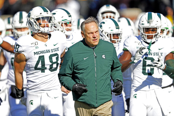 FILE - In this Nov. 16, 2019, file photo, Michigan State head coach Mark Dantonio leads the team onto the field before an NCAA college football game against Michigan in Ann Arbor, Mich. Dantonio announced his retirement Tuesday, Feb. 4, 2020, ending a 13-year run in which he guided the Spartans to heights they hadn't reached in decades. (AP Photo/Paul Sancya, File)