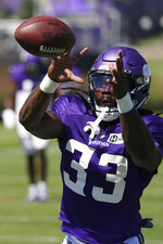 Minnesota Vikings running back Dalvin Cook catches a pass during a joint NFL football practice with the Denver Broncos on Wednesday, Aug. 11, 2021, in Eagan, Minn. (Anthony Souffle/Star Tribune via AP)