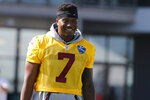 Washington Redskins quarterback Dwayne Haskins Jr. (7) heads to the practice field during the first day of the Washington Redskins NFL football training camp in Richmond, Va., Thursday, July 25, 2019. (AP Photo/Steve Helber)