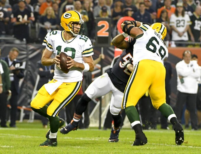 Green Bay Packers' Aaron Rodgers drops back during the first half of an NFL football game against the Chicago Bears Thursday, Sept. 5, 2019, in Chicago. (AP Photo/David Banks)