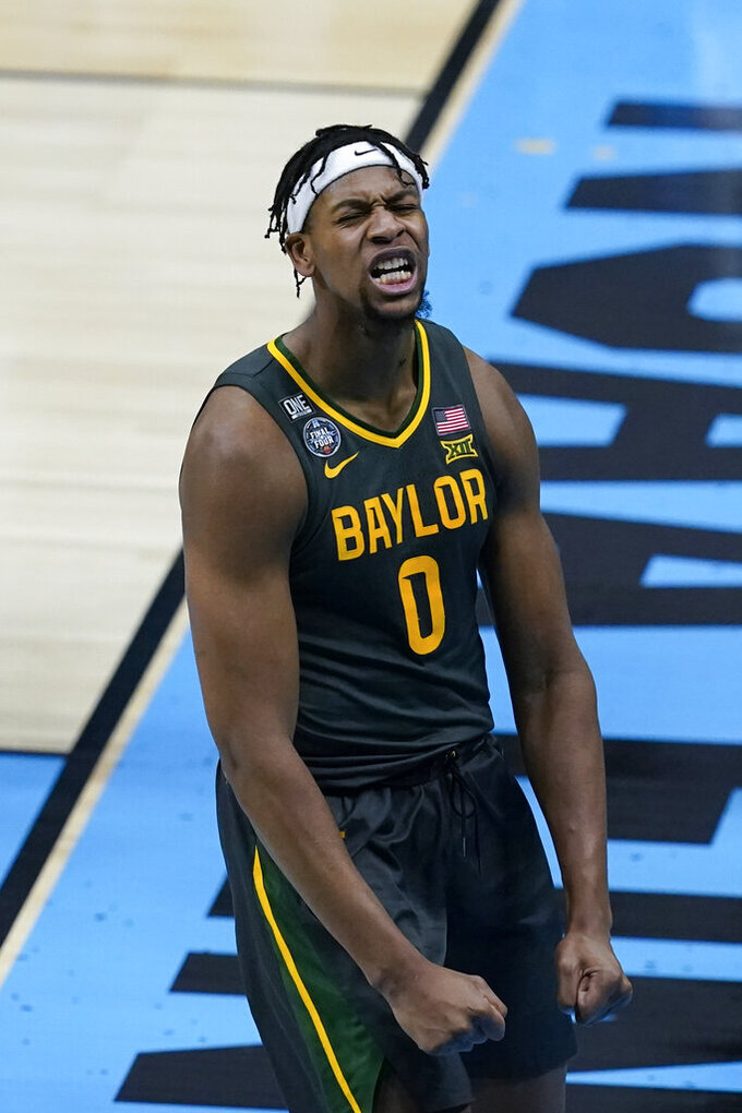 Baylor forward Flo Thamba (0) celebrates after blocking a shot by Gonzaga forward Corey Kispert during the first half of the championship game in the men's Final Four NCAA college basketball tournament, Monday, April 5, 2021, at Lucas Oil Stadium in Indianapolis. (AP Photo/Darron Cummings)