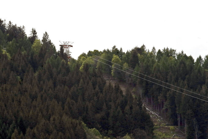 A view of the cable car line that collapsed near Stresa, Italy, Sunday, May 23, 2021. A cable car taking visitors to a mountaintop view of some of northern Italy's most picturesque lakes plummeted to the ground Sunday and then tumbled down the slope, killing at least 13 people and sending two children to the hospital, authorities said. (AP Photo/Antonio Calanni)