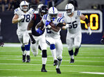 Indianapolis Colts running back Marlon Mack (25) runs against the Houston Texans during the second half of an NFL wild card playoff football game, Saturday, Jan. 5, 2019, in Houston. (AP Photo/Eric Christian Smith)
