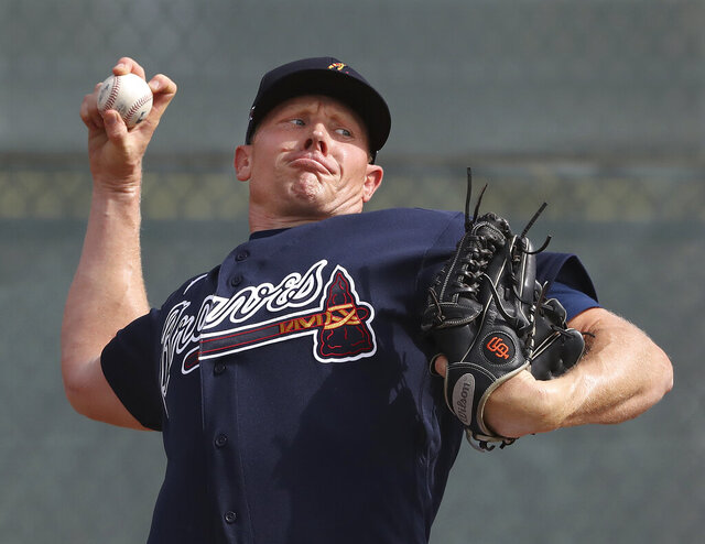 Atlanta Braves pitcher Mark Melancon throws at baseball spring training camp in North Port, Fla., Friday, Feb. 14, 2020. (Curtis Compton/Atlanta Journal-Constitution via AP)