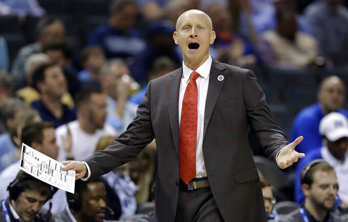 Louisville head coach Chris Mack reacts to a call during the first half of an NCAA college basketball game against North Carolina in the Atlantic Coast Conference tournament in Charlotte, N.C., Thursday, March 14, 2019. (AP Photo/Chuck Burton)