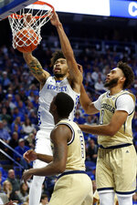 Kentucky's Nick Richards, top left, dunks near Georgia Tech's Moses Wright (5) and James Banks III during the first half of an NCAA college basketball game in Lexington, Ky., Saturday, Dec. 14, 2019. (AP Photo/James Crisp)