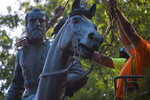 """The monument of Stonewall Jackson is prepared to be lifted from its pedestal on Saturday, July 10, 2021 in Charlottesville, Va.   The removal of the Lee and Jackson statues comes nearly four years after violence erupted at the infamous """"Unite the Right"""" rally.  (AP Photo/John C Clark)"""