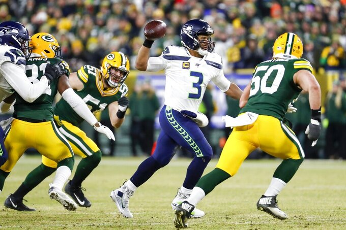 Seattle Seahawks quarterback Russell Wilson throws during the first half of an NFL divisional playoff football game against the Green Bay Packers Sunday, Jan. 12, 2020, in Green Bay, Wis. (AP Photo/Matt Ludtke)