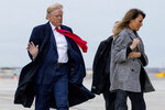 President Donald Trump and first lady Melania Trump walk to board Air Force One on a cold and windy afternoon at John F. Kennedy International Airport in New York, Tuesday, Nov. 12, 2019, to travel to Washington. (AP Photo/Andrew Harnik)