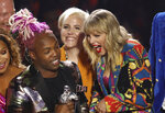 Taylor Swift, right, accepts the video for good award for