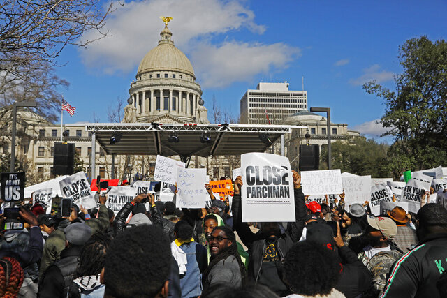 FILE - In this Jan. 24, 2020 file photo, several hundred people gather in front of the Mississippi Capitol in Jackson, to protest conditions in prisons where inmates have been killed in violent clashes in recent weeks. U.S. Justice Department announced in February that it was investigating Mississippi's prison system, and a new Department of Corrections Commissioner Burl Cain said he would improve prisons with