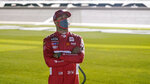 Bubba Wallace stands on pit road as he waits for the second of two qualifying NASCAR auto races for the Daytona 500 at Daytona International Speedway, Thursday, Feb. 11, 2021, in Daytona Beach, Fla. (AP Photo/John Raoux)