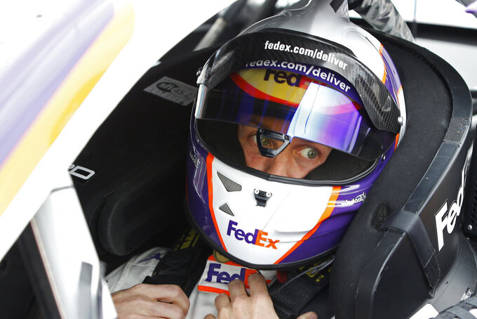 Denny Hamlin looks on from his race car prior to the NASCAR Cup Series auto race at Phoenix Raceway, Sunday, Nov. 8, 2020, in Avondale, Ariz. (AP Photo/Ralph Freso)