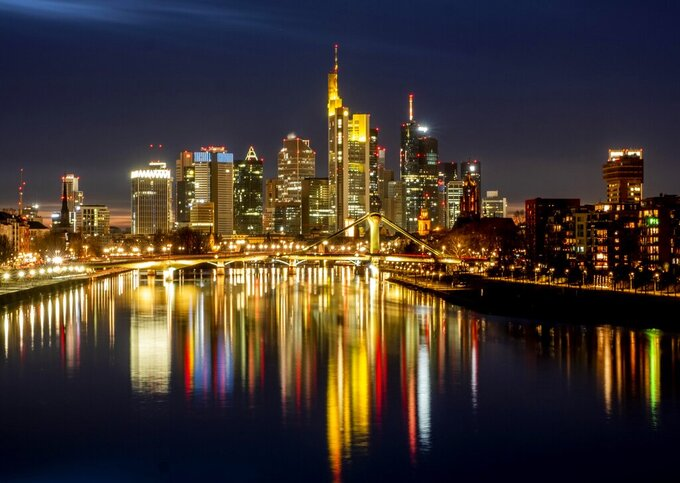 FILE - In this Feb.14, 2021 file photo the lights of the bridges and buildings are reflected in the river Main in Frankfurt, Germany, Germany Economy. The German economy, Europe's biggest, may grow by up to 4% this year as the coronavirus pandemic recedes, a senior official said Thursday. (AP Photo/Michael Probst, file)