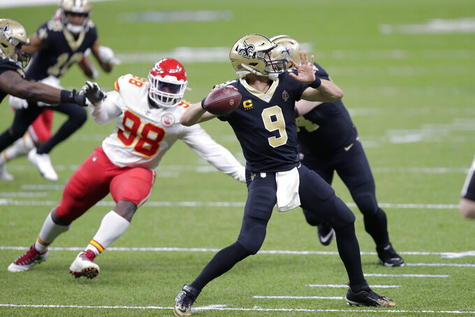 New Orleans Saints quarterback Drew Brees (9) passes under pressure from Kansas City Chiefs defensive tackle Tershawn Wharton (98) in the first half of an NFL football game in New Orleans, Sunday, Dec. 20, 2020. (AP Photo/Brett Duke)