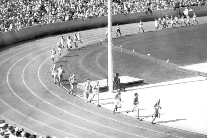 FILE - In this Aug,. 7, 1932, file photo, competitors circle the track before starting their grueling run through the streets of Los Angeles, during the marathon at the Olympics. Juan Carlos Zabala, Argentine, leads and won the event. (AP Photo/File)