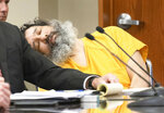 Anthony Garcia appears unresponsive at the Douglas County Court in Omaha, Neb., Friday, Sept. 14, 2018. Garcia, a former doctor, was convicted in the revenge killings of four people connected to a Nebraska medical school and has been sentenced to death by a three-judge panel. The first victims were the son and housekeeper of a faculty member at Creighton University School of Medicine in Omaha. Garcia also was found guilty in the 2013 deaths of another Creighton pathology doctor and his wife. (Kent Sievers/Omaha World-Herald via AP, Pool)