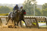 Essential Quality (2), with jockey Luis Saez up, crosses the finish line ahead of Hot Rod Charlie (4), with jockey Flavien Prat up, to win the 153rd running of the Belmont Stakes horse race, Saturday, June 5, 2021, At Belmont Park in Elmont, N.Y. (AP Photo/Eduardo Munoz Alvarez)