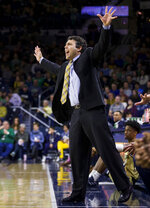 Georgia Tech head coach Josh Pastner directs players to hold their hands up on defense during the first half of an NCAA college basketball game against Notre Dame on Saturday, Feb. 1, 2020, in South Bend, Ind. Notre Dame won 72-80. (AP Photo/Robert Franklin)