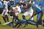 Tampa Bay Buccaneers running back Peyton Barber (25) is upended by Carolina Panthers cornerback Donte Jackson during the first half of an NFL football game in Charlotte, N.C., Thursday, Sept. 12, 2019. (AP Photo/Mike McCarn)