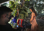 A model poses during a photo shoot for the Lotus Make-up India Fashion Week, at  the farmhouse of a designer, in New Delhi, India, Friday, Oct. 2, 2020. Unlike a fashion show, they aren't swaying live on a ramp. They are depending on digital technology to rescue their annual extravaganza from the coronavirus pandemic with ''Phygital edition.