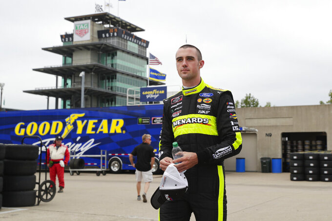 NASCAR Xfinity Series driver Austin Cindric walks to his garage before the start of NASCAR Xfinity auto racing practice at Indianapolis Motor Speedway, Friday, Sept. 6, 2019 in Indianapolis. (AP Photo/Michael Conroy)