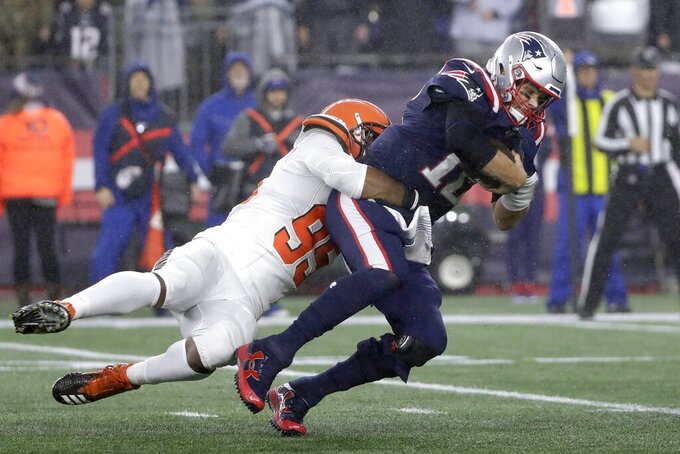 Cleveland Browns defensive end Myles Garrett, left, sacks New England Patriots quarterback Tom Brady in the second half of an NFL football game, Sunday, Oct. 27, 2019, in Foxborough, Mass. (AP Photo/Elise Amendola)