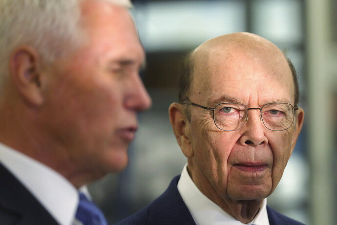 FILE - In this Aug. 22, 2019, file photo, U.S. Commerce Secretary Wilbur Ross, right, looks on as U.S. Vice President Mike Pence speaks to the media at medical-device manufacturer Merit Medical in South Jordan, Utah. U.S. Secretary of Commerce Wilbur Ross has slammed China's trade practices and trumpeted America's economic relationship with Australia amid a festering trade war with Beijing. (AP Photo/Rick Bowmer, File)