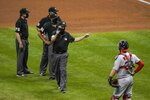 Umpire Ron Kulpa warns both teams after Milwaukee Brewers' Ryan Braun was hit by a pitch during the fifth inning of the second game of a baseball doubleheader against the St. Louis Cardinals Wednesday, Sept. 16, 2020, in Milwaukee. (AP Photo/Morry Gash)