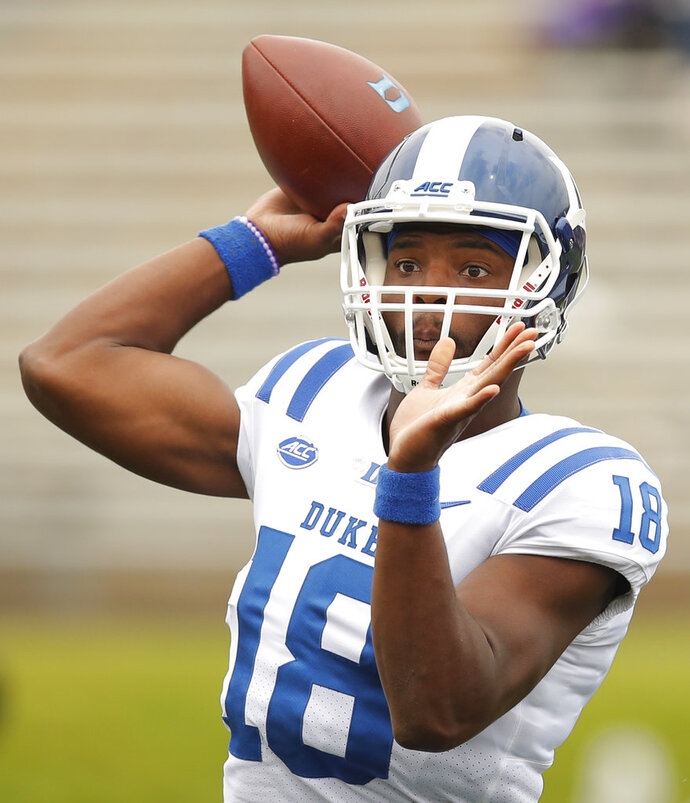 FILE - In this Saturday, Sept. 8, 2018, file photo, Duke's Quentin Harris throws a pass during the second half of an NCAA college football game against Northwestern in Evanston, Ill. Before leaving North Carolina a day early for Texas to get out ahead of Hurricane Florence, and changing their final preparations for Saturday's game against Baylor, the Blue Devils were already getting Harris ready for his first career start in place of injured Daniel Jones. (AP Photo/Jim Young, File)