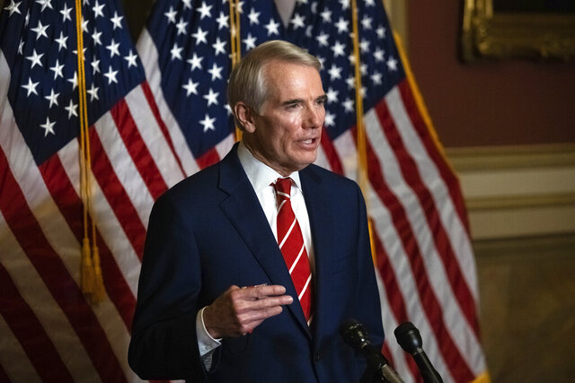 FILE - This Monday, Oct. 26, 2020, file photo shows Sen. Rob Portman, R-Ohio, speaking during a news conference in Washington. Portman is participating in a COVID-19 vaccine study, hoping to encourage others to volunteer to take part in testing. Portman said in an interview that as much as he supports such precautions as masking and social distancing, vaccine development, distribution and use are the best hope for reducing the pandemic's toll, and he wanted to what he could to help