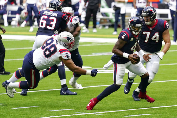 Houston Texans quarterback Deshaun Watson (4) runs for a touchdown against the New England Patriots during the first half of an NFL football game, Sunday, Nov. 22, 2020, in Houston. (AP Photo/David J. Phillip)