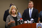 St. Louis Mayor Lyda Krewson speaks as U.S. Attorney Jeff Jensen, right, listens during a news conference Thursday, Aug. 6, 2020, in St. Louis. Officials announced St. Louis has been added to the list of cities that will receive assistance from Operation Legend, a federal anti-crime program launched to help city police in their effort to reduce violent crime. (AP Photo/Jeff Roberson)