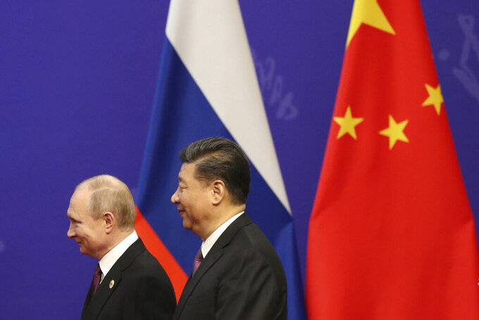 """FILE - In this April 26, 2019, file photo, Russian President Vladimir Putin, left, and Chinese President Xi Jinping, right, attend an event at the Friendship Palace in Beijing. Putin and Xi have developed strong personal ties helping bolster a """"strategic partnership"""" between the two former Communist rivals. (Kenzaburo Fukuhara/Pool Photo via AP, File)"""