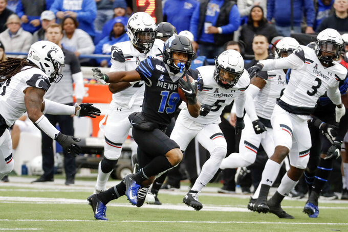 Memphis running back Kenneth Gainwell (19) carries the ball against Cincinnati in the first half of an NCAA college football game Friday, Nov. 29, 2019, in Memphis, Tenn. (AP Photo/Mark Humphrey)
