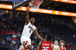 Oregon State's Alfred Hollins (4) dunks against Utah during the first half of an NCAA college basketball game in the first round of the Pac-12 men's tournament Wednesday, March 11, 2020, in Las Vegas. (AP Photo/John Locher)