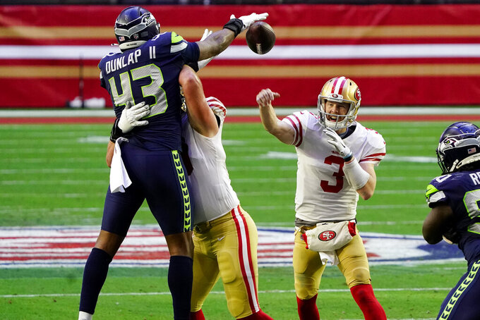San Francisco 49ers quarterback C.J. Beathard (3) has his pass blocked by Seattle Seahawks defensive end Carlos Dunlap (43) during the first half of an NFL football game, Sunday, Jan. 3, 2021, in Glendale, Ariz. (AP Photo/Rick Scuteri)