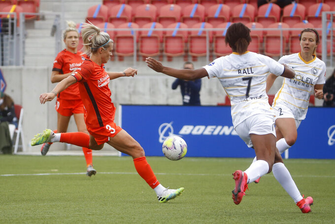 Houston Dash forward Rachel Daly (3) scores past Utah Royals FC defender Elizabeth Ball (7) during the first half of an NWSL Challenge Cup soccer match at Zions Bank Stadium Tuesday, June 30, 2020, in Herriman, Utah. (AP Photo/Rick Bowmer)