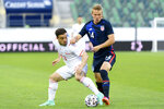 Switzerland's Xherdan Shaqiri, left, and USA's Jackson Yueill, right, fight for the ball during a friendly soccer match between Switzerland and the USA, at the kybunpark stadium in St. Gallen, Switzerland, Sunday, May 30, 2021. (Georgios Kefalas/Keystone via AP)