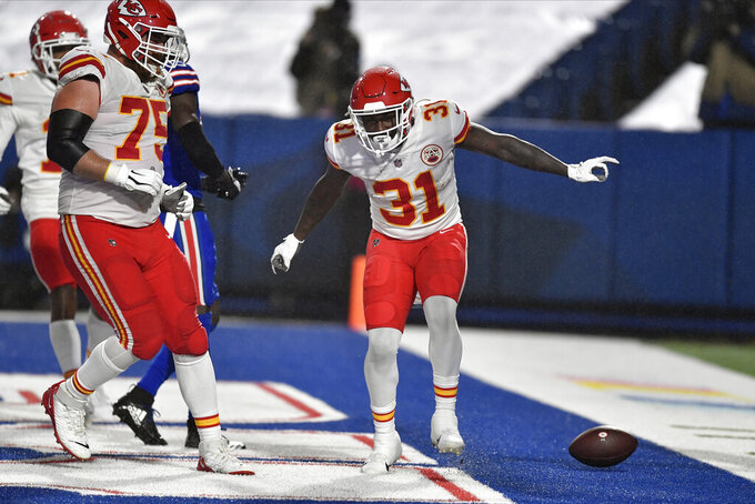 Kansas City Chiefs' Darrel Williams, right, celebrates his touchdown during the second half of an NFL football game against the Buffalo Bills, Monday, Oct. 19, 2020, in Orchard Park, N.Y. (AP Photo/Adrian Kraus)