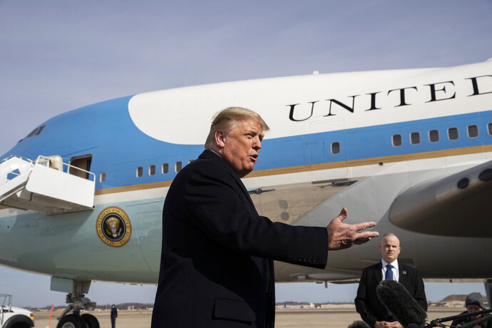 President Donald Trump speaks with reporters as he boards Air Force One as he departs Tuesday, Feb. 18, 2020, at Andrews Air Force Base, Md.(AP Photo/Alex Brandon)