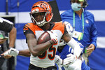 Cincinnati Bengals' Tee Higgins (85) is tackled by Indianapolis Colts' Rock Ya-Sin (26) during the first half of an NFL football game, Sunday, Oct. 18, 2020, in Indianapolis. (AP Photo/AJ Mast)