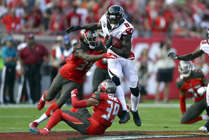 Tampa Bay Buccaneers defensive back Jamel Dean (35) and strong safety Andrew Adams (39) team up to stop Atlanta Falcons wide receiver Julio Jones (11) after a catch during the first half of an NFL football game Sunday, Dec. 29, 2019, in Tampa, Fla. (AP Photo/Jason Behnken)